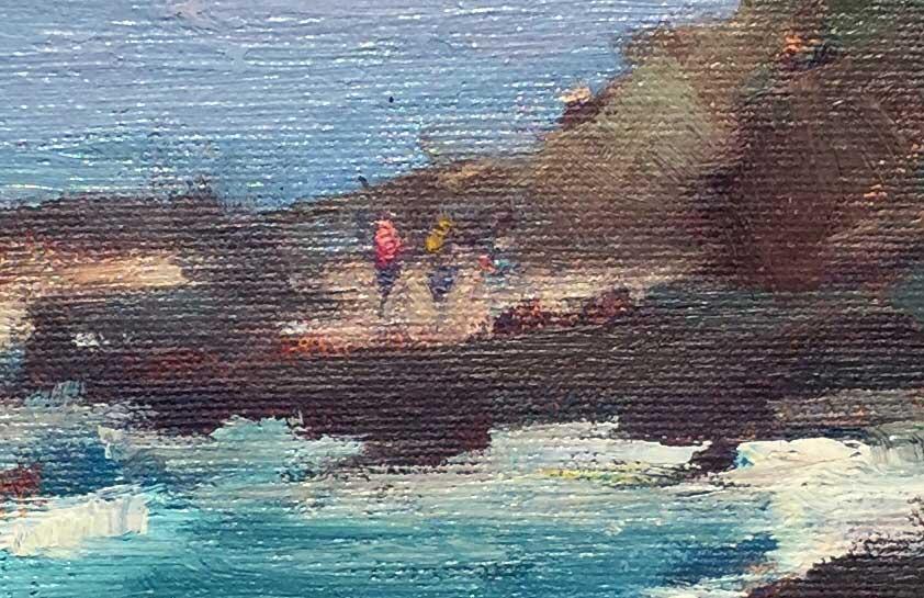 Detail of people in rocks in Woods Cove Laguna Beach